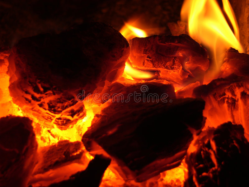 Glow in stove stock photography