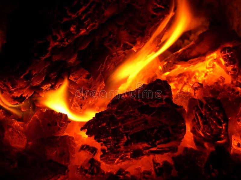 Glow in stove stock photos