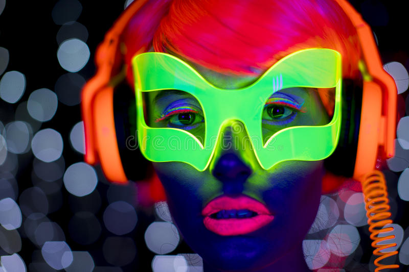Glow uv neon disco female cyber doll robot electronic toy royalty free stock photography