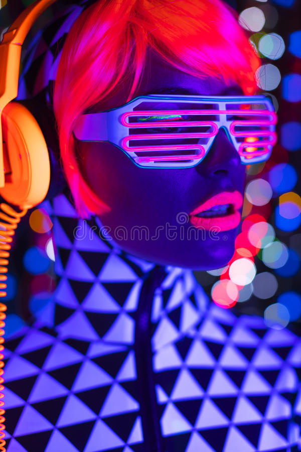 Glow uv neon disco female cyber doll robot electronic toy royalty free stock images