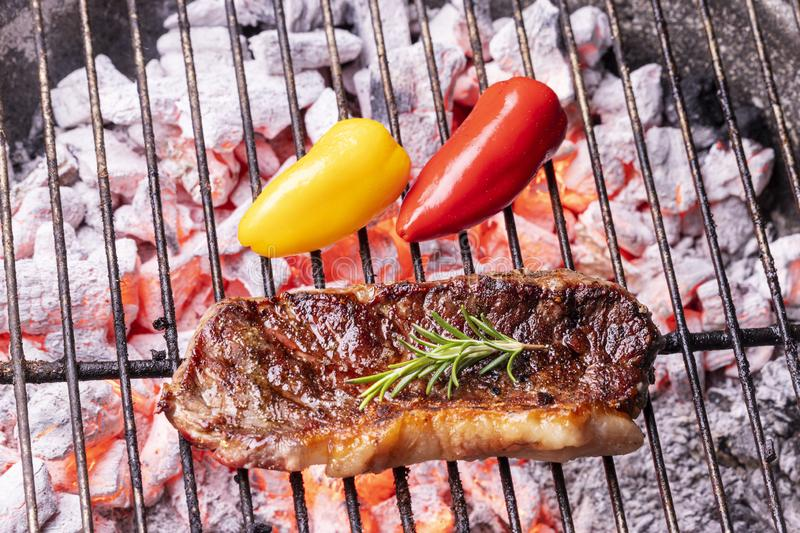 Glowin charcoal with a steak royalty free stock image