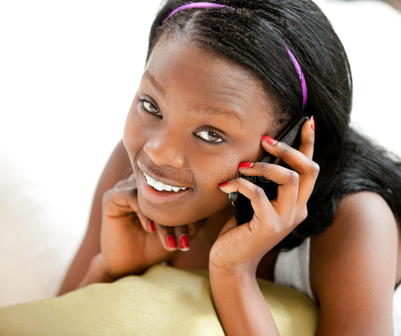 Glowing Afro-american Teenager Talking On Phone Royalty Free Stock Photo