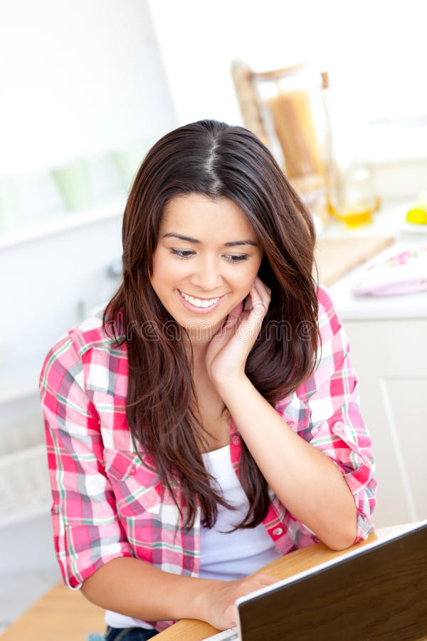 Download Glowing Asian Woman Using Laptop In The Kitchen Stock Image - Image: 15621871