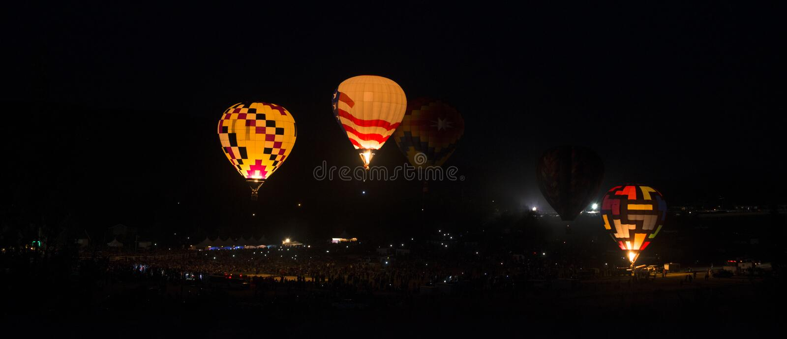 Glowing Balloons. Glowing hot-air balloons float and perform a light show stock photography