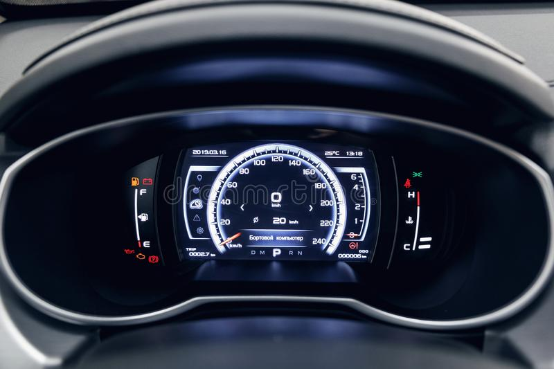 Glowing beautiful dashboard of a modern expensive car stock photography