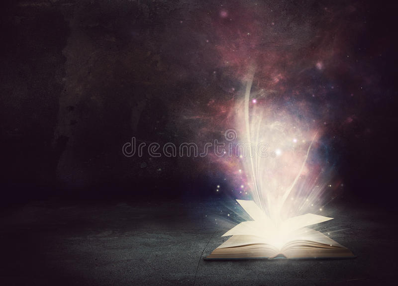 Glowing Book. With lights and colors royalty free stock photo