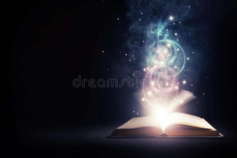 Glowing Book with colors. Open glowing book with bright lights and colors royalty free stock image