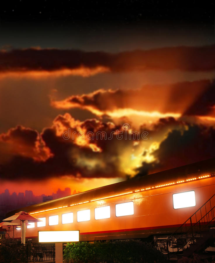 Glowing boxcar. Dramatic fantasy concept photo of a glowing old railway boxcar against dramatic sunset stock photography