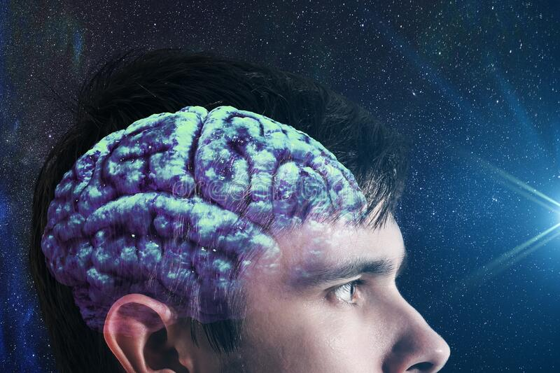 Glowing brain inside man`s head. Consciousness concept. stock photography