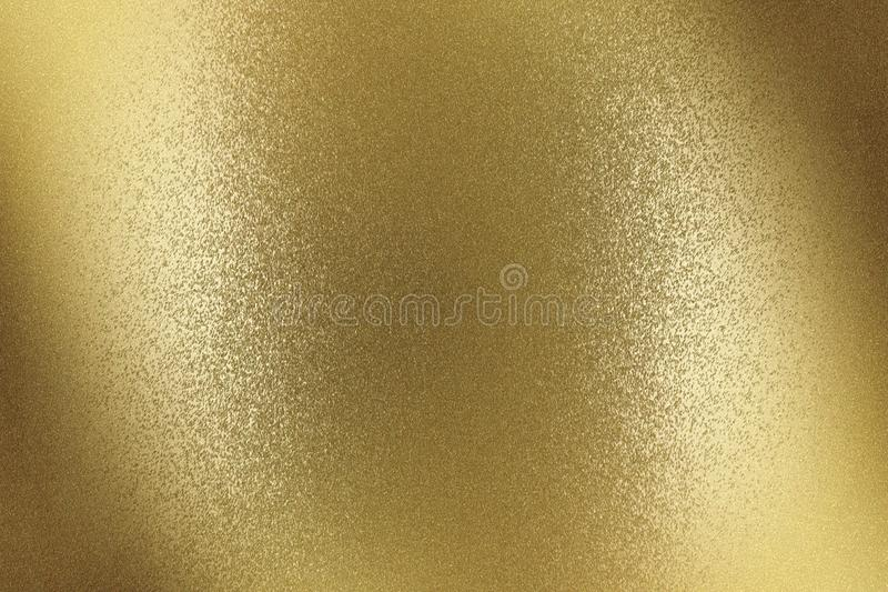 Glowing brushed bronze metal wall surface, abstract texture background royalty free stock images