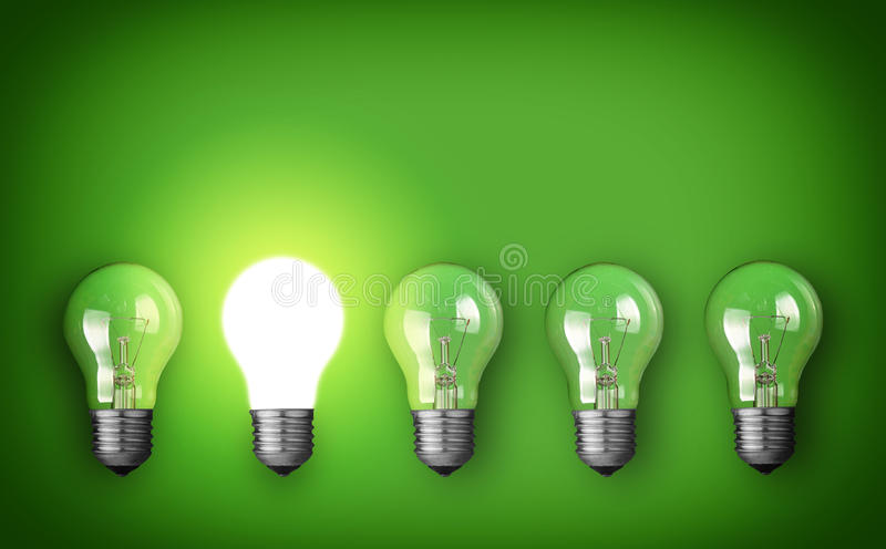 Glowing bulb. Idea concept with row of light bulbs and glowing bulb stock images