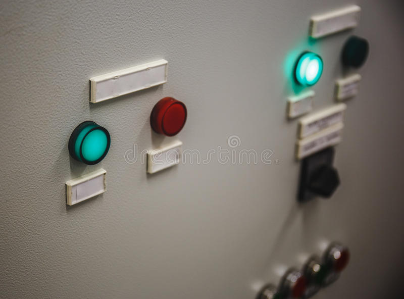 Glowing buttons on the dashboard. Retro style royalty free stock images