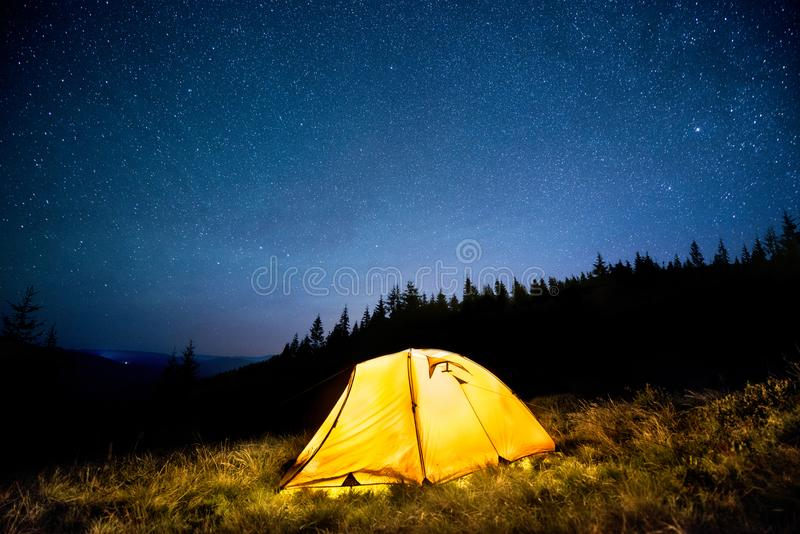 Glowing Camping Tent In The Night Mountain Forest Under A ...