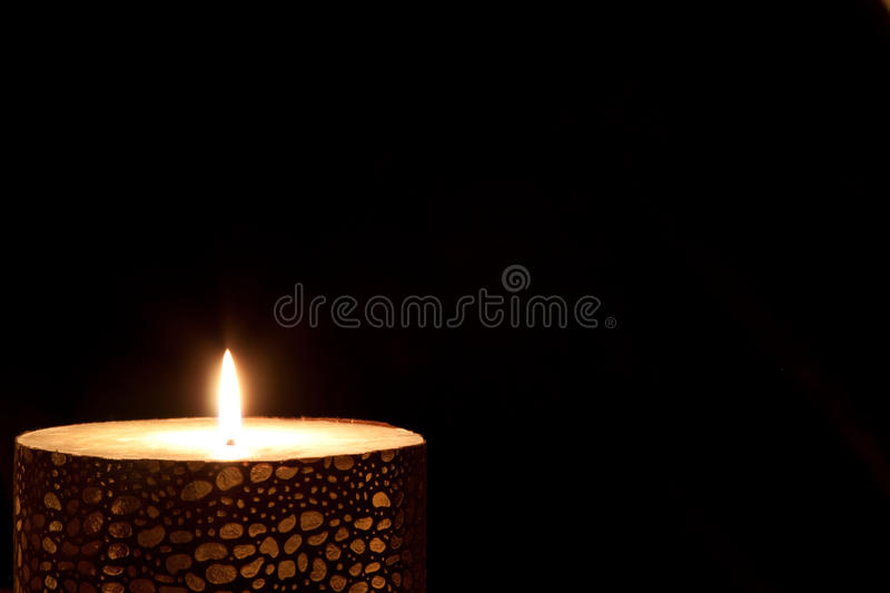 Glowing candle stock images