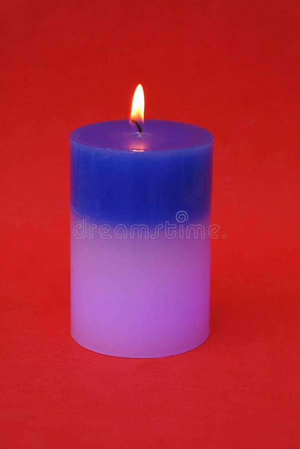 Glowing candle. Which changes it's color royalty free stock photography