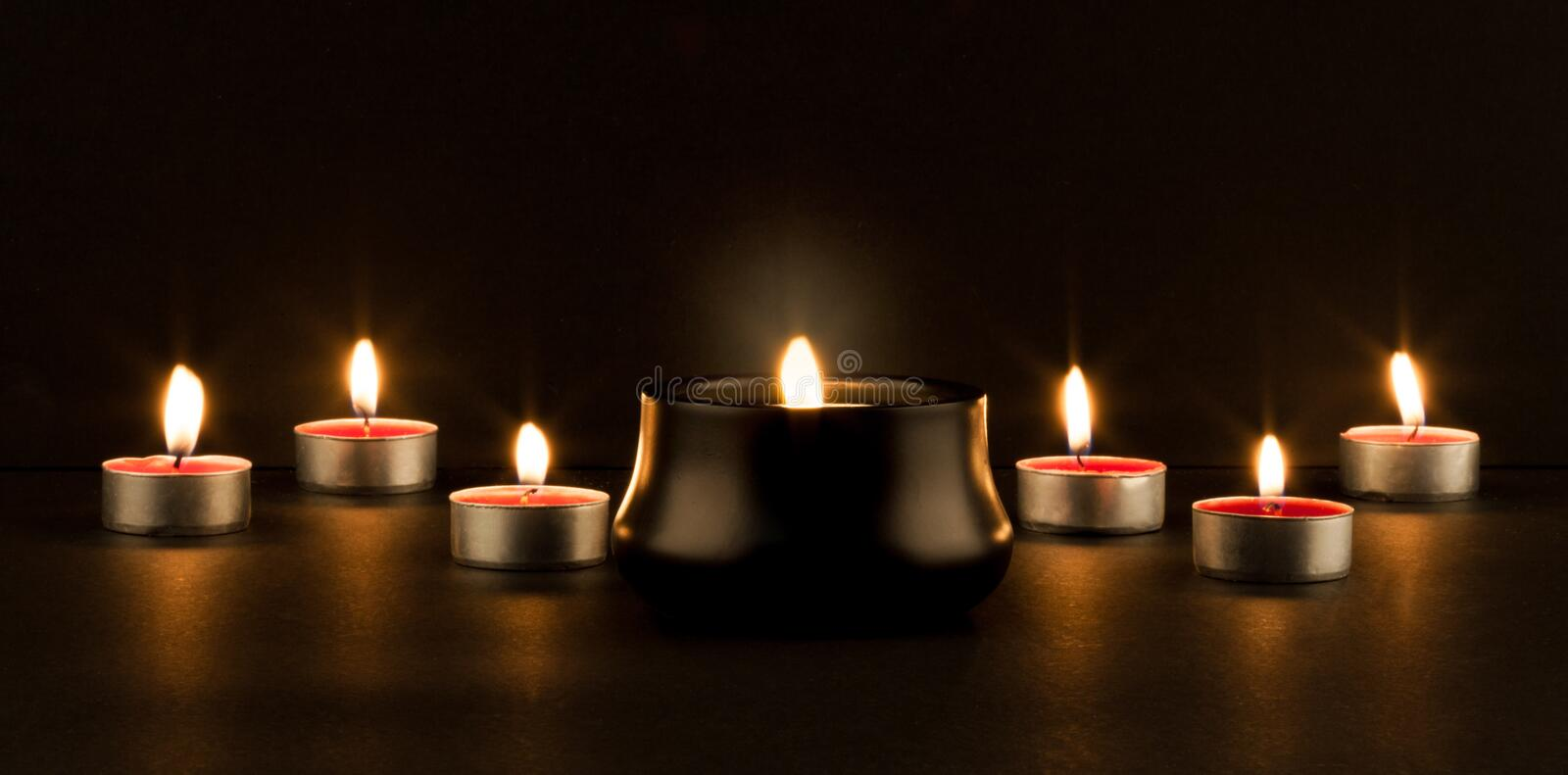 Glowing candles stock photos