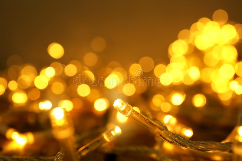 Glowing Christmas lights on table. Closeup view royalty free stock photos