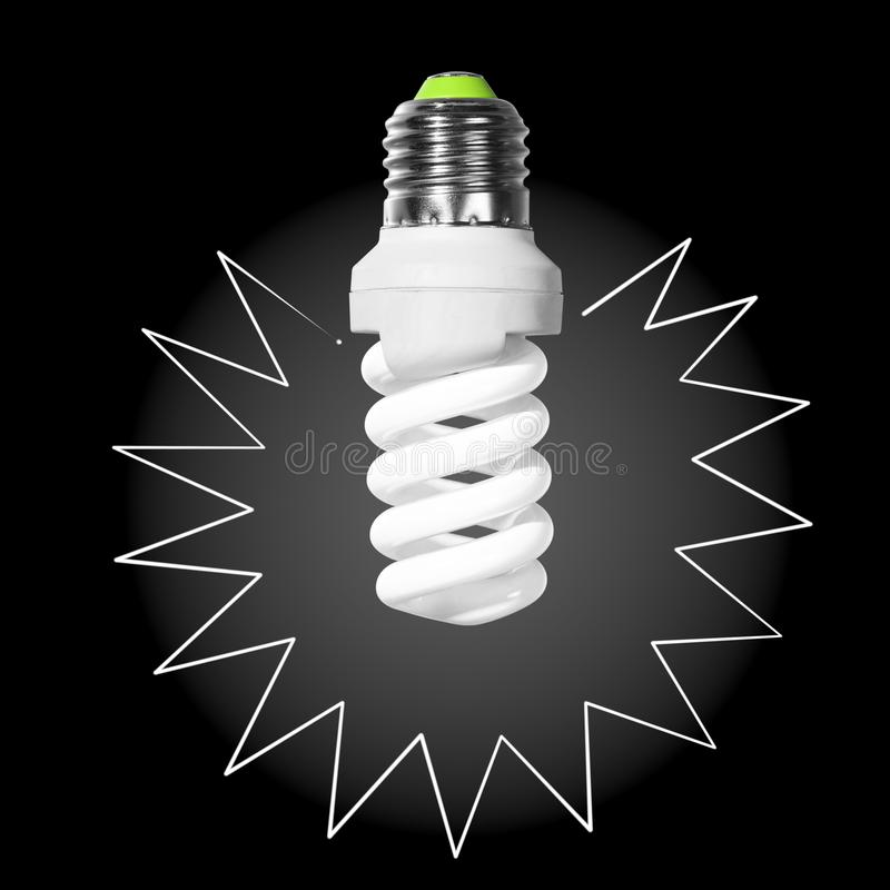 Glowing compact fluorescent light bulb with spiral tube and with painted beams royalty free stock photography