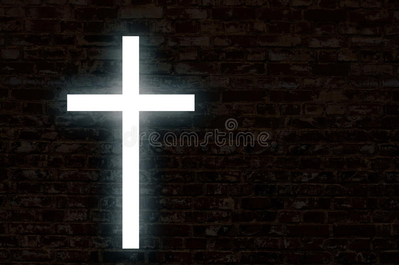 Glowing cross on a brick wall. Church background royalty free stock photos
