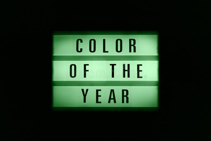 Glowing in the dark box of neon green with the inscription Color of the Year royalty free stock photography