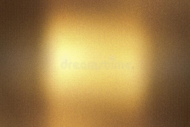 Glowing dark brown foil metallic wall with scratched surface, abstract texture background royalty free stock photography