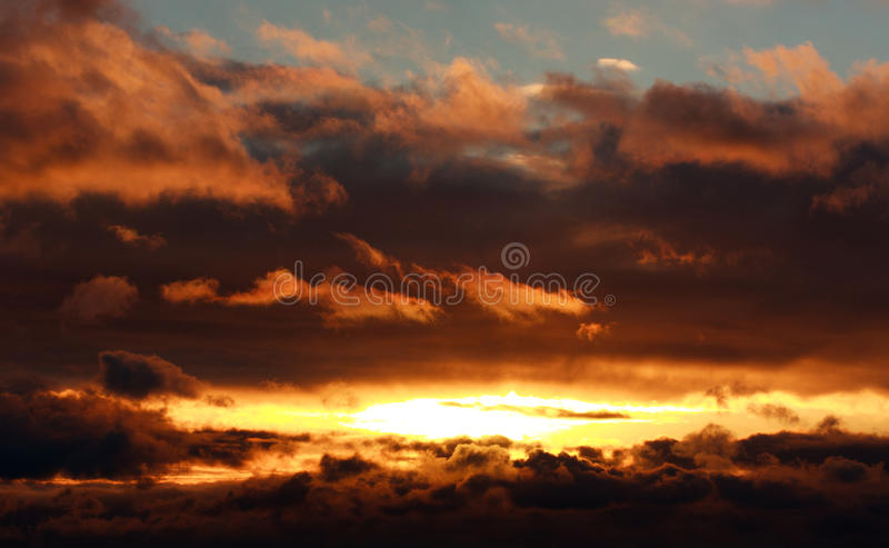 Glowing dramatic sunset clouds in sky, nature background stock photos