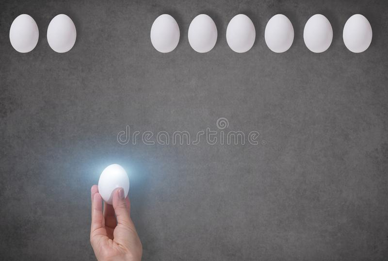 Glowing Egg In A Female Hand On A Gray Background A Symbol Of Right