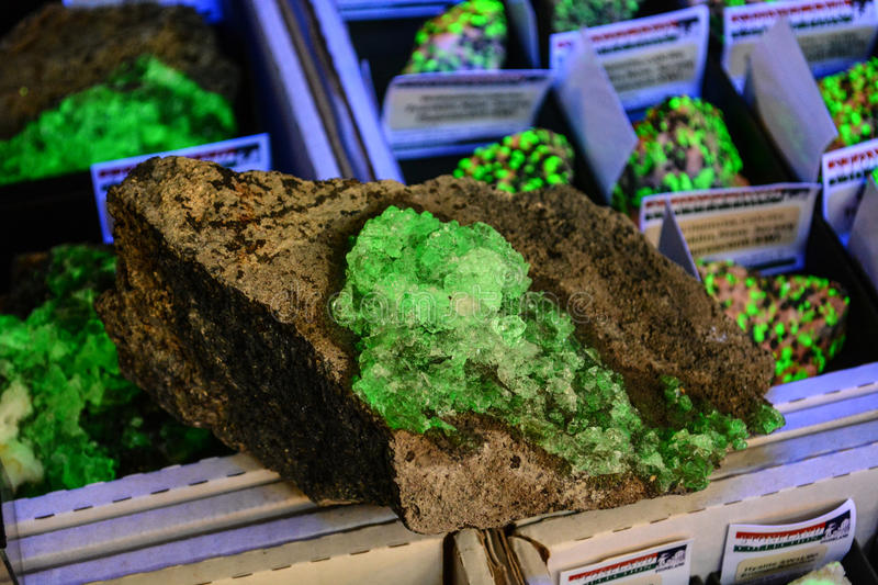 Glowing emerald-green mineral stock photo