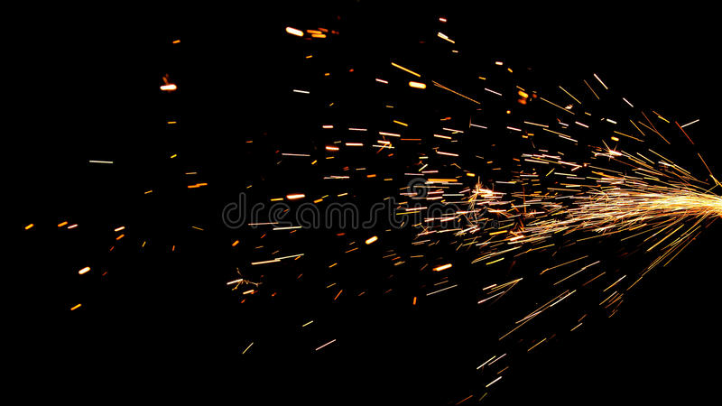 Glowing Flow of Sparks in the Dark stock image