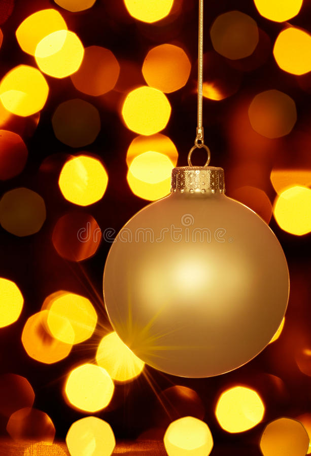 Glowing Gold Christmas Ornament And Holiday Lights Stock Images