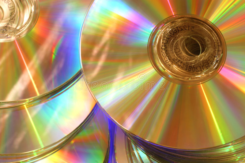 Glowing golden rainbow compact disks stock image