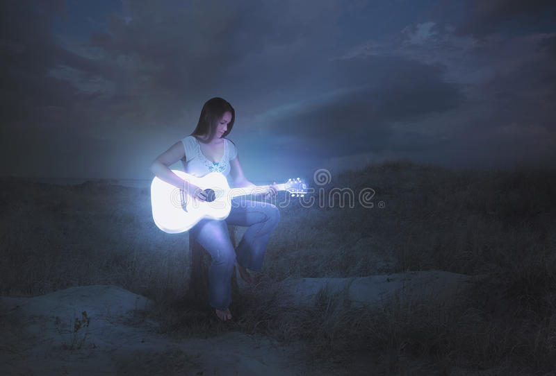 Glowing guitar at night stock images