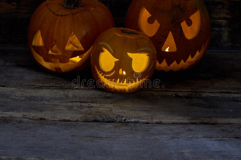 Glowing Halloween pumpkin heads jack lantern. royalty free stock photography