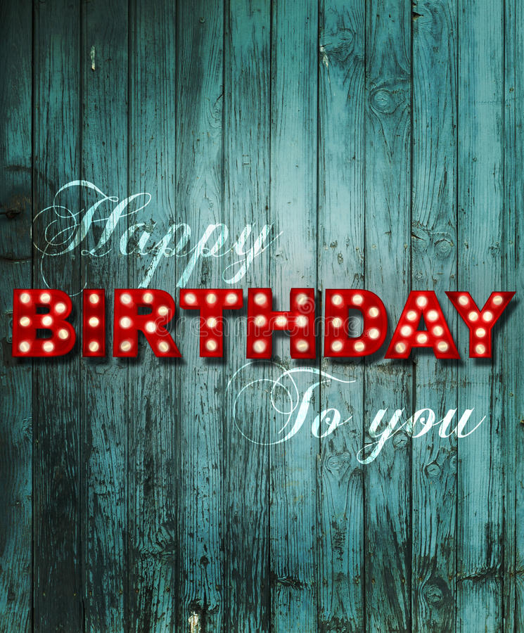 Glowing Happy Birthday on wooden background stock illustration