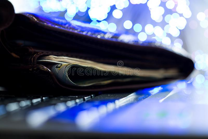 Glowing high speed internet optical fibres, opened wallet on computer keyboard stock photography