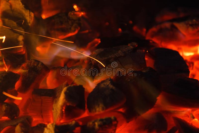 Glowing hot charcoal briquettes close-up background texture. bonfire royalty free stock images