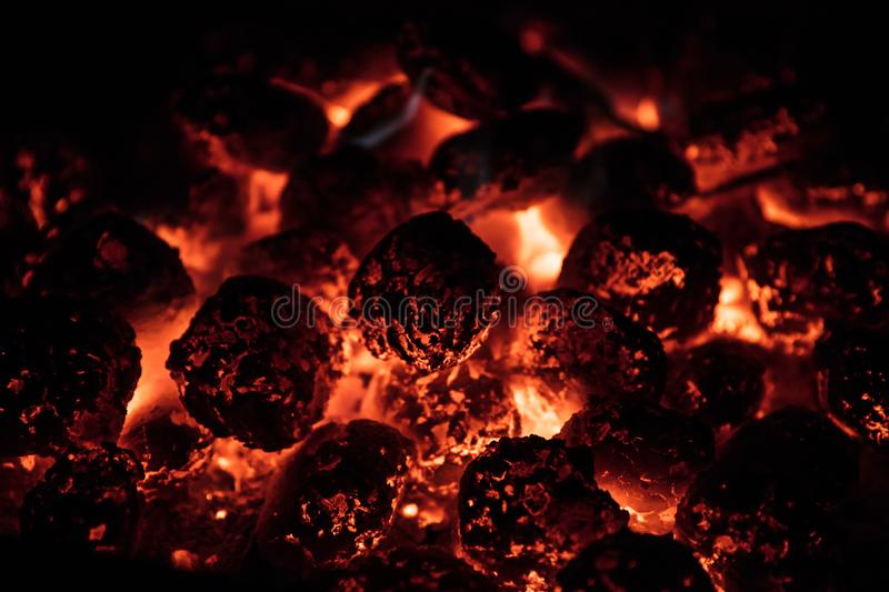 Glowing Hot Charcoal Briquettes on garden grill, close-Up, royalty free stock photography