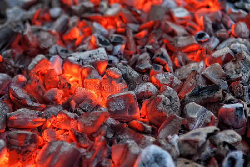 Glowing hot red embers for cooking barbecue. Close-up texture stock photos