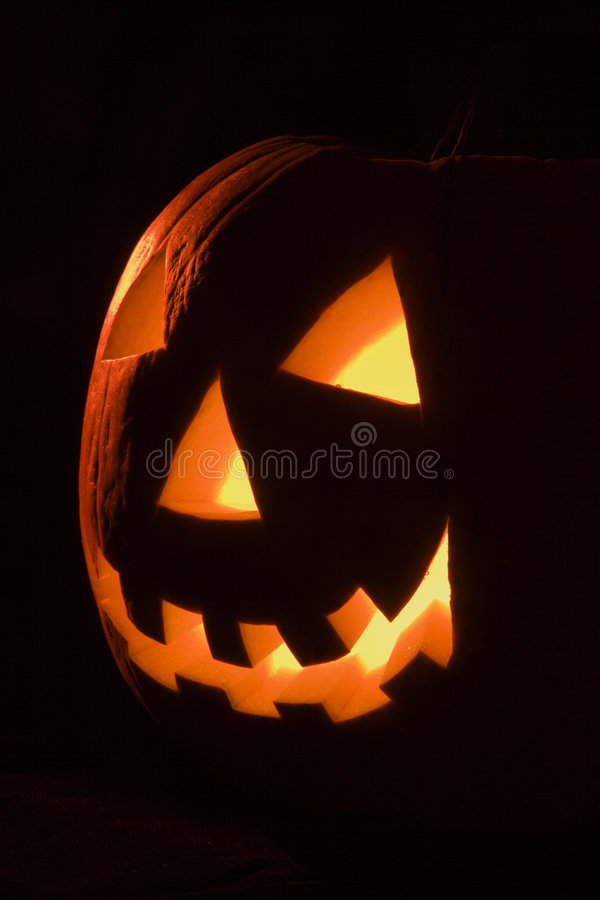 Glowing jack-o'-lantern. stock photo