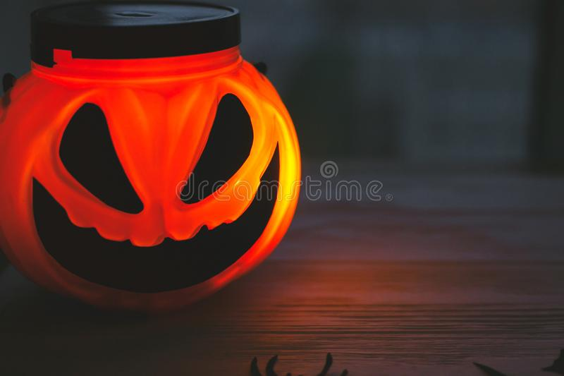 Glowing Jack-o-lantern head in dark. Happy Halloween. Jack o lantern glowing face pumpkin on black background. Trick or treat. Copy space stock images