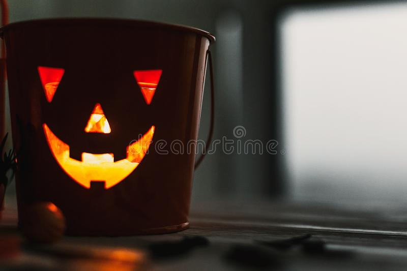 Glowing Jack-o-lantern head in dark. Happy Halloween. Jack o lantern glowing face pumpkin on black background. Trick or treat. Copy space royalty free stock photo