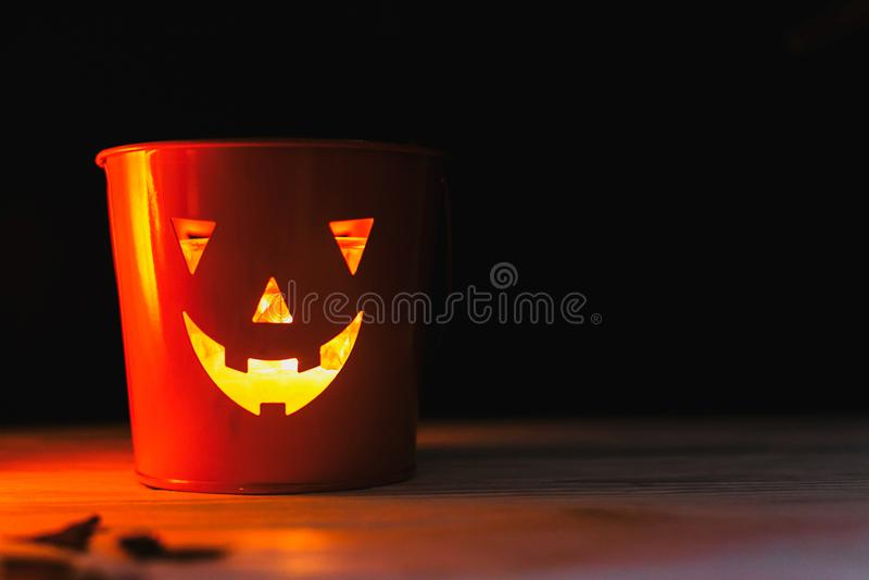 Glowing Jack-o-lantern head in dark. Happy Halloween. Jack o lantern glowing face pumpkin on black background. Trick or treat. stock image