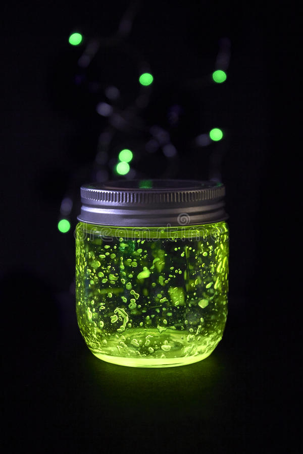 Glowing jar in the darkness stock image