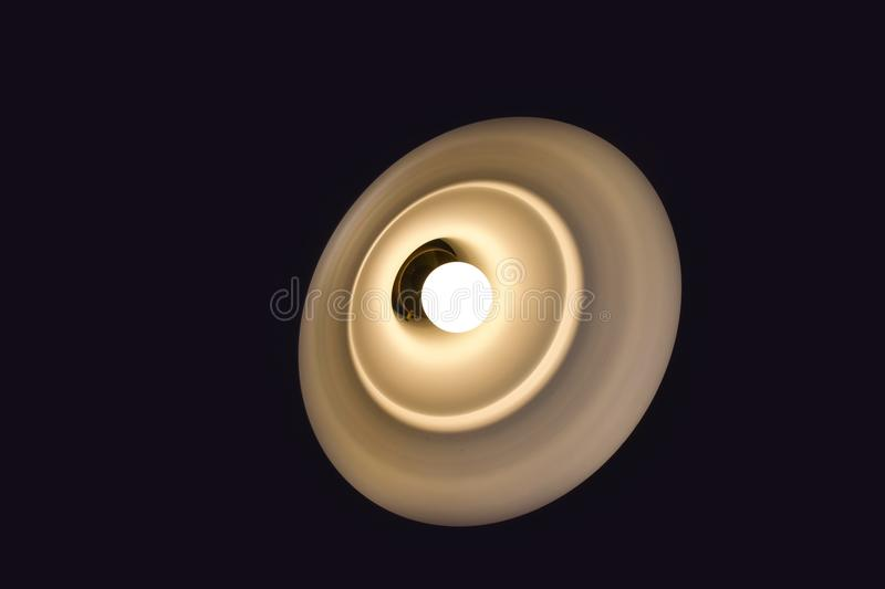 A glowing lamp in the dark. Simple, concise forms. A glowing lamp in the dark. The design is made in simple and concise forms royalty free stock images