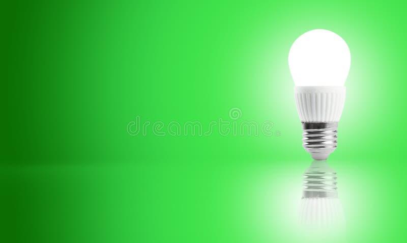 Glowing LED energy saving bulb. royalty free stock image