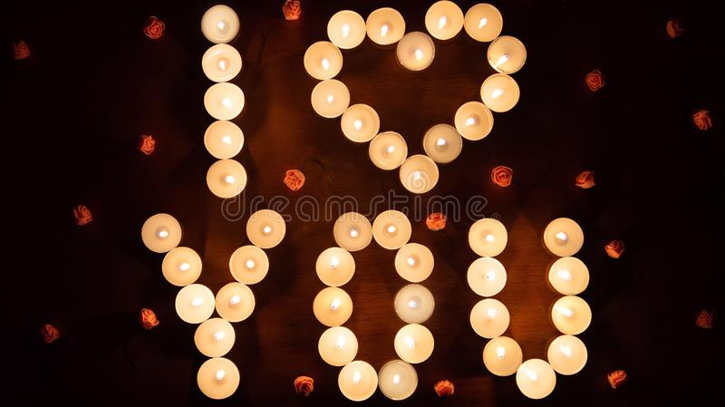 Glowing lettering I LOVE YOU made by burning candles. St. Valentine`s Day concept stock photo