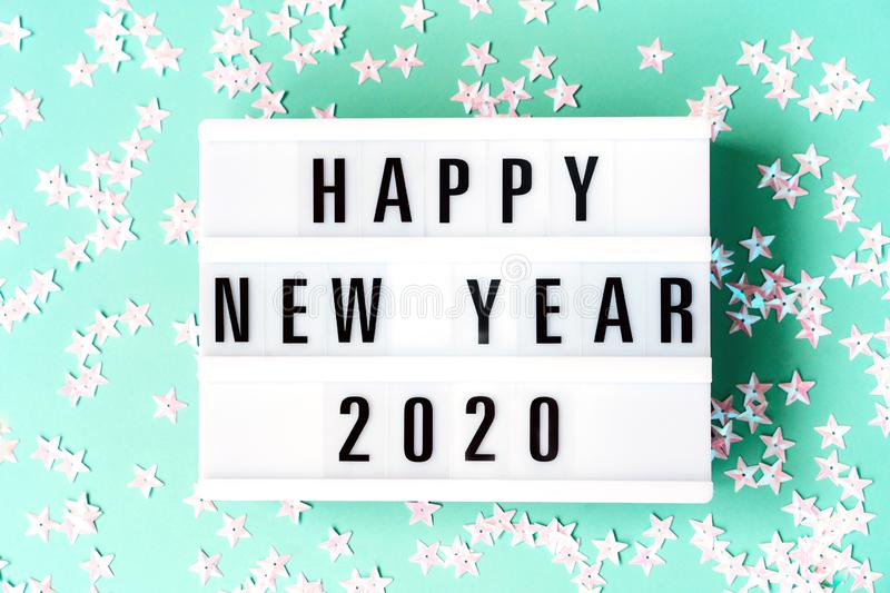 Glowing light box with the inscription Happy New Year 2020 stock images