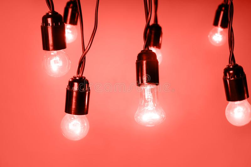 Glowing light bulbs on grey background stock images