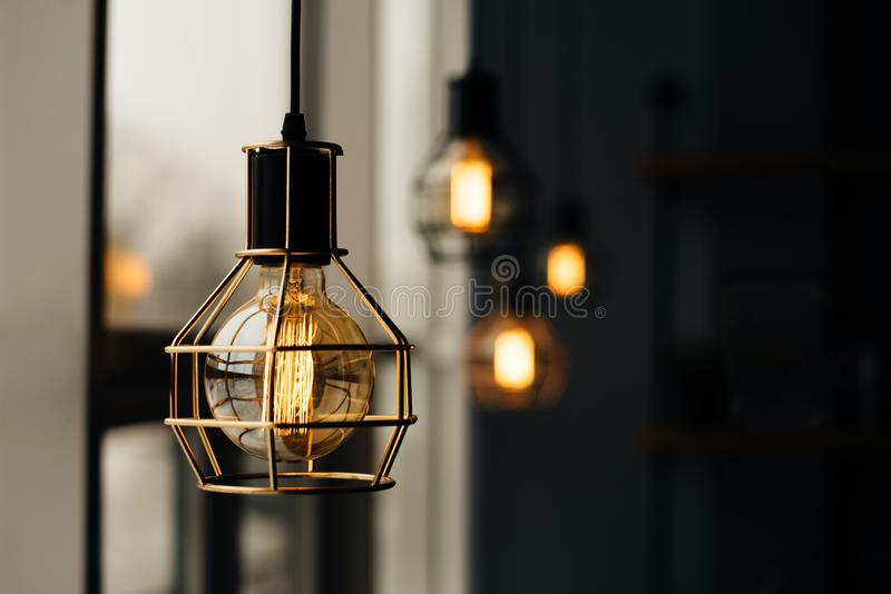Glowing light bulbs in the loft style royalty free stock photo