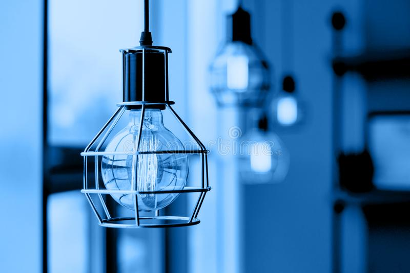 Glowing light bulbs in the loft style. stock photos